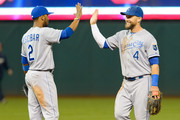 Alcides Escobar #2 and Alex Gordon #4 of the Kansas City Royals celebrate a 7-1 win over the Cleveland Indians at Progressive Field on September 23, 2014 in Cleveland, Ohio.