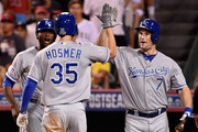 Eric Hosmer #35 celebrates with Lorenzo Cain #6 and Josh Willingham #7 of the Kansas City Royals after hitting a two-run home run in the elventh inning against the Los Angeles Angels during Game Two of the American League Division Series at Angel Stadium of Anaheim on October 3, 2014 in Anaheim, California.