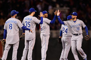 (L-R) Mike Moustakas #8, Eric Hosmer #35, Alcides Escobar #2, Christian Colon #24 and Paulo Orlando #16 of the Kansas City Royals celebrate a win against the Minnesota Twins on October 2, 2015 at Target Field in Minneapolis, Minnesota. The Royals defeated the Twins 3-1.