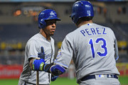 Adalberto Mondesi #27 of the Kansas City Royals is met by Salvador Perez #13 after hitting a solo home run in the third inning during the game against the Pittsburgh Pirates at PNC Park on September 19, 2018 in Pittsburgh, Pennsylvania.