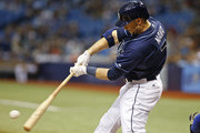 Daniel Nava #7 of the Tampa Bay Rays flies out to center field during the first inning of a game against the Kansas City Royals on August 29, 2015 at Tropicana Field in St. Petersburg, Florida.