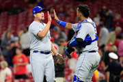 Jake Newberry #68 of the Kansas City Royals celebrates with Salvador Perez #13  after the final out of the 6-1 win over the Cincinnati Reds at Great American Ball Park on September 26, 2018 in Cincinnati, Ohio.