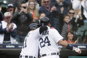 Miguel Cabrera #24 of the Detroit Tigers is hugged by Victor Martinez #41 of the Detroit Tigers after scoring on Martinez's sacrifice fly ball during the seventh inning at Comerica Park on April 21, 2018 in Detroit, Michigan. The Tigers defeated the Royals 12-4.