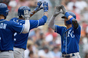 Alex Gordon #4 and Alcides Escobar #2 of the Kansas City Royals congratulate teammate Whit Merrifield #15 on a two-run home run against the Minnesota Twins during the seventh inning of the game on August 5, 2018 at Target Field in Minneapolis, Minnesota. The Twins defeated the Royals 6-5.