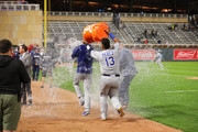 Salvador Perez #13 dumps the cooler of water on Jorge Lopez #52 of the Kansas City Royals after the Royals defeated the Twins 4-1 at Target Field on September 8, 2018 in Minneapolis, Minnesota.