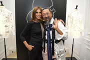 "Carine Roitfeld and Takashi Murakami attends the ""Tribute to the Karl Lagerfeld: The White Shirt Project"" exhibition as part of Paris Fashion Week in Paris on September 25, 2019."