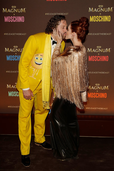 Magnum party - The 70th Annual Cannes Film Festival [yellow,interaction,outerwear,kiss,flooring,jacket,premiere,fashion design,kate gorney,tj miller,cannes,france,magnum beach,magnum,party,cannes film festival]