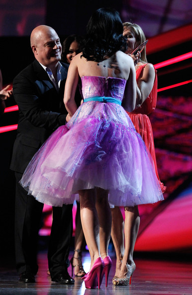 Katy Perry Musician Katy Perry aka Katy Brand accepts the awards for Favorite Online Sensation and Favorite Female Artist onstage during the 2011 People's Choice Awards at Nokia Theatre L.A. Live on January 5, 2011 in Los Angeles, California.