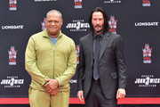 Laurence Fishburne and Keanu Reeves attend 'Keanu Reeves places his hand prints in cement' at TCL Chinese Theatre IMAX on May 14, 2019 in Hollywood, California.