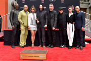 (L-R) Lance Reddick, Laurence Fishburne, Halle Berry, Keanu Reeves, Director Chad Stahelski, Ian McShane, Asia Kate Dillon and Mark Dacascos attend a handprint ceremony honoring Reeves at the TCL Chinese Theatre IMAX forecourt on May 14, 2019 in Hollywood, California.