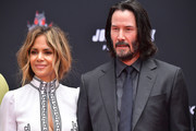 Halle Berry and Keanu Reeves attend 'Keanu Reeves places his hand prints in cement' at TCL Chinese Theatre IMAX on May 14, 2019 in Hollywood, California.