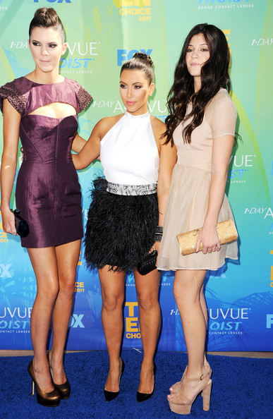 Kendall Jenner (L-R) TV personalities Kendall Jenner, Kim Kardashian and Kylie Jenner arrive at the 2011 Teen Choice Awards held at the Gibson Amphitheatre on August 7, 2011 in Universal City, California.
