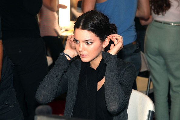 Kendall Jenner Kendall Jenner prepares backstage at the Evening Sherri Hill Spring 2012 fashion show during Mercedes-Benz Fashion Week on September 14, 2011 in New York City.
