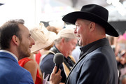 Tracy Lawrence answers interviews during the 145th Kentucky Derby at Churchill Downs on May 04, 2019 in Louisville, Kentucky.