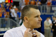 Head coach Billy Donovan of the Florida Gators takes off his tie after the game against the Kentucky Wildcats at the Stephen C. O'Connell Center on March 8, 2014 in Gainesville, Florida.