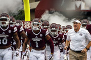 Head coach Dan Mullen of the Mississippi State Bulldogs takes the field with his team before the start of an NCAA football game against the Kentucky Wildcats at Davis Wade Stadium on October 21, 2017 in Starkville, Mississippi.