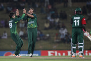 Shahid Afridi (C) of Pakistan celebrates with Ahmed Shehzad (L) after taking the wicket of Jimmy Kamande (R) during the Kenya v Pakistan 2011 ICC World Cup Group A match at the Mahinda Rajapaksa International Cricket Stadium on February 23, 2011 in Hambantota, Sri Lanka.
