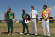 Shahid Afridi (L) captain of Pakistan,Jimmy Kamande (2L) captain of Kenya,Chris Broad (2R) ICC match referee and Pepsi winner (R) at the coin toss during the Kenya v Pakistan 2011 ICC World Cup Group A match at the Mahinda Rajapaksa International Cricket Stadium on February 23, 2011 in Hambantota, Sri Lanka.