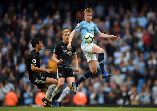 Manchester City v Burnley FC - Premier League [player,sports,sports equipment,football player,team sport,ball game,football,soccer player,soccer,sport venue,kevin de bruyne,jack cork,v,ball,burnley fc,etihad stadium,manchester,manchester city,premier league,match]