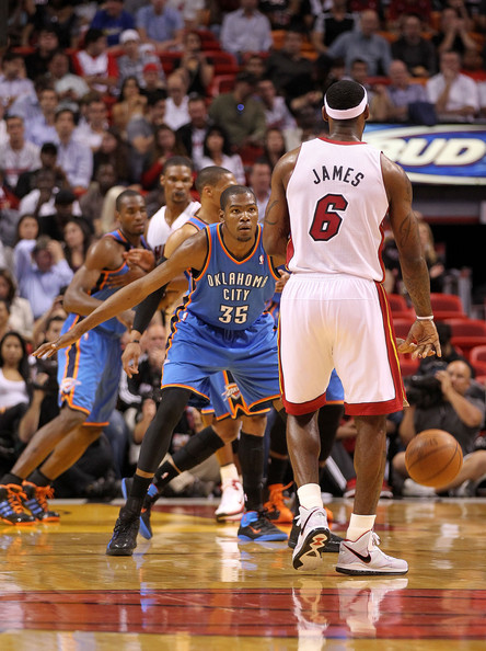 Kevin Durant LeBron James #6 of the Miami Heat is guarded by Kevin Durant #35 of the Oklahoma City Thunder during a game at American Airlines Arena on March 16, 2011 in Miami, Florida. NOTE TO USER: User expressly acknowledges and agrees that, by downloading and/or using this Photograph, User is consenting to the terms and conditions of the Getty Images License Agreement.