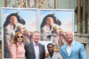 Kevin Hart (C) poses with Karen Gillan (L) Will Ferrell (2L) and Dwayne Johnson as he is honored with a Hand and Footprint ceremony at the TCL Chinese Theatre IMAX on December 10, 2019 in Hollywood, California.