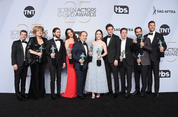 25th Annual Screen Actors Guild Awards - Press Room [event,premiere,fashion,carpet,award,ceremony,formal wear,flooring,suit,white-collar worker,screen actors guild awards,l-r,awards,room,press room,michael zegen,caroline aaron,joel johnstone,marin hinkle,brian tarantina]