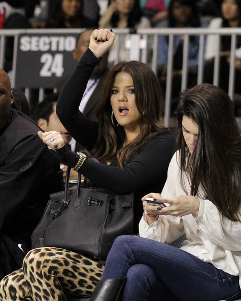 Khloe Kardashian Khloe Kardashian plays at the 2011 BBVA NBA All-Star Celebrity Game at the Los Angeles Convention Center on February 18, 2011 in Los Angeles, California.
