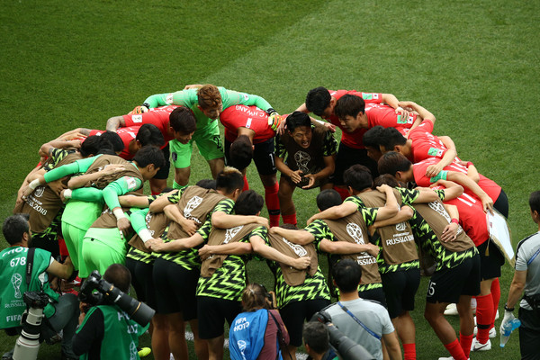Korea Republic vs. Mexico: Group F - 2018 FIFA World Cup Russia [team,team sport,sports,stadium,sport venue,rugby,player,rugby sevens,fan,crowd,team huddle,korea republic,russia,rostov-on-don,mexico,rostov arena,group,mexico: group f - 2018 fifa world cup,match]