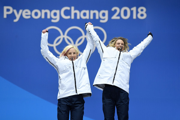 Medal Ceremony - Winter Olympics Day 13 [fun,gesture,happy,cheering,font,technology,advertising,team,smile,leisure,united states,medal plaza,pyeongchang-gun,medal ceremony,winter olympics,medal ceremony,gold medalists,kikkan randall,jessica diggins,cross-country skiing - ladies]