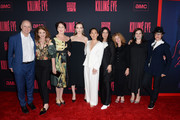 """(L-R)  President of Programming, AMC David Madden, Executive Producer Sally Woodward Gentle, Fiona Shaw, Jodie Comer, Sandra Oh, President, AMC Sarah Barnett, Executive Producer Gina Mingacci, Executive Director, BBC America Courtney Thomasma and Killing Eve Director Francesca Gregorini attend the """"Killing Eve"""" premiere event on April 01, 2019 in North Hollywood, California."""