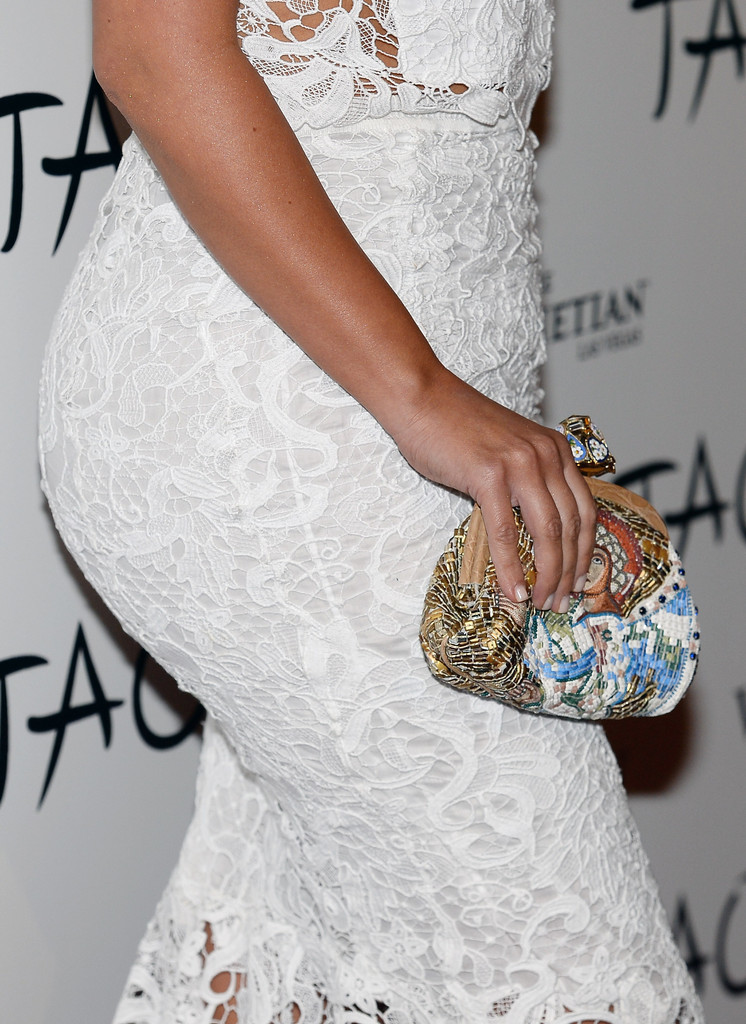 Television personality Kim Kardashian (purse detail) arrives at the Tao Nightclub at The Venetian Las Vegas to celebrate her 33rd birthday on October 26, 2013 in Las Vegas, Nevada.