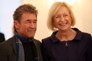 German musician Peter Maffay (L) and Education Minister Johanna Wanka (CDU) attend a lunch at Bellevue presidential palace during the Spanish-German Forum on November 18, 2015 in Berlin, Germany. The biennial event, whose location rotates between Spain and Germany, brings together political and business leaders from the two countries.
