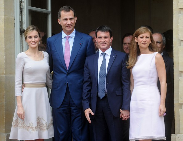 Queen Letizia of Spain, King Felipe VI of Spain, French Prime Minister Manuel Valls and his wife French violonist Anne Gravoin exit the Hotel Matignon on July 22, 2014 in Paris, France. King Felipe VI and Queen Letizia of Spain are on an offical day visit in France.