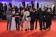 "(R-L) Liz Watts, Ben Mendelsohn, Jeremy Kleiner, Sean Harris, Tom Glynn-Carney, Timothée Chalamet, producer Dede Gardner, director David Michod, Lily-Rose Depp and Joel Edgerton attends ""The King"" red carpet during the 76th Venice Film Festival at Sala Grande on September 02, 2019 in Venice, Italy."