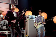 Caleb Followill (L) and Jared Followill of Kings Of Leon perform on stage on AT&T at iHeartRadio Theater LA on January 30, 2017 in Burbank, California.