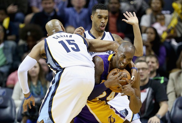 Los Angeles Lakers v Memphis Grizzlies [sports,team sport,ball game,basketball player,basketball,basketball moves,player,tournament,sport venue,product,kobe bryant,vince carter,courtney lee,defense,los angeles lakes,fedexforum,memphis,memphis grizzlies,los angeles lakers,game]