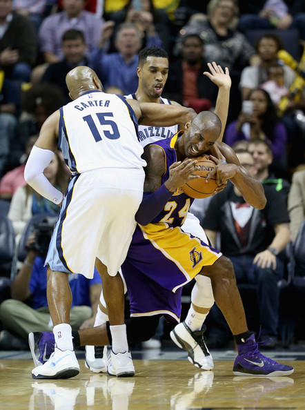 Los Angeles Lakers v Memphis Grizzlies [basketball,player,sports,tournament,basketball player,team sport,basketball moves,ball game,sport venue,kobe bryant,vince carter,courtney lee,defense,los angeles lakes,fedexforum,memphis,memphis grizzlies,los angeles lakers,game]