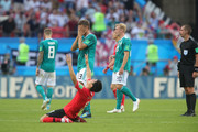 Referee Mark Geiger ends the match whilst Thomas Mueller of Germany and Sejong Ju of Korea Republic reacts during the 2018 FIFA World Cup Russia group F match between Korea Republic and Germany at Kazan Arena on June 27, 2018 in Kazan, Russia.