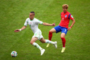 Djamel Mesbah of Algeria and Son Heung-Min of South Korea compete for the ball during the 2014 FIFA World Cup Brazil Group H match between South Korea and Algeria at Estadio Beira-Rio on June 22, 2014 in Porto Alegre, Brazil.