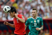 Yong Lee of Korea Republic wins a header during the 2018 FIFA World Cup Russia group F match between Korea Republic and Germany at Kazan Arena on June 27, 2018 in Kazan, Russia.