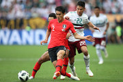 Yong Lee of Korea Republic is challenged by Hirving Lozano of Mexico  during the 2018 FIFA World Cup Russia group F match between Korea Republic and Mexico at Rostov Arena on June 23, 2018 in Rostov-on-Don, Russia.