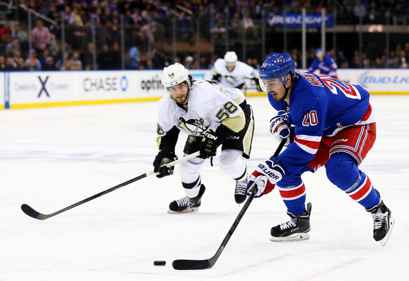 Kris Letang Chris Kreider #20 of the New York Rangers controls the puck against Kris Letang #58 of the Pittsburgh Penguins in the second period during Game Six of the Second Round of the 2014 NHL Stanley Cup Playoffs at Madison Square Garden on May 11, 2014 in New York City.