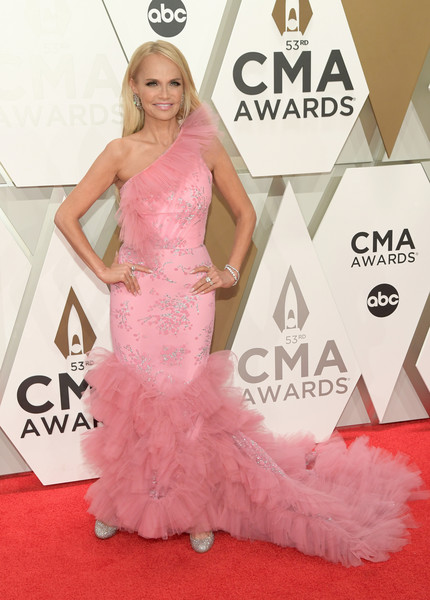 The 53rd Annual CMA Awards - Arrivals [dress,red carpet,gown,clothing,carpet,shoulder,pink,fashion model,flooring,hairstyle,arrivals,kristin chenoweth,cma awards,nashville,tennessee,music city center]
