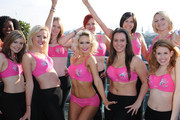 Kris Hallenga (2L) and Kristina Rhianoff (C) attend a photocall to launch a Breast Cancer Awareness sports bra on October 9, 2012 in London, England.