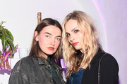 Models Alina Baikova (L) and Andreja Pejic attends L'Eden By Perrier-Jouet Cocktail Party With Derek Blasberg on November 30, 2016 in Miami Beach, Florida.