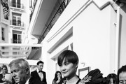 Image has been digitally altered) Li Yuchun departs the Martinez Hotel during the 71st annual Cannes Film Festival at  on May 8, 2018 in Cannes, France.