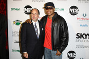 """Recording artist LL Cool J (R) and Allan Ellinger attend the second annual """"Pay It Fashion Forward"""" party at M2 Ultra Lounge on June 18, 2009 in New York City."""