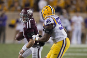 Trevor Knight #8 of the Texas A&M Aggies runs with the ball as he is pursued by Lewis Neal #92 of the LSU Tigers at Kyle Field on November 24, 2016 in College Station, Texas.