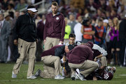 Head coach Kevin Sumlin of the Texas A&M Aggies, left, looks on as Trevor Knight #8 is looked at after suffering an apparent knee injury against the LSU Tigers at Kyle Field on November 24, 2016 in College Station, Texas.