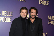 """Guillaume Canet and Nicolas Bedos attend the """"La Belle Epoque"""" premiere at cinema Gaumont Opera Capucines on October 17, 2019 in Paris, France."""